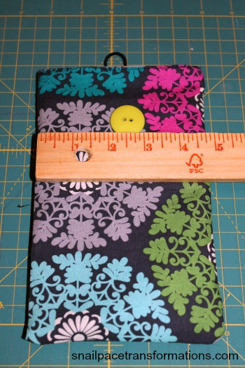 placing the button on the kindle paperwhite case