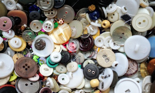 Thrifty people cut buttons off of worn-out garments of clothing to use on crafts.