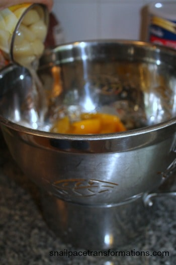 straining the juice from the peaches and pears