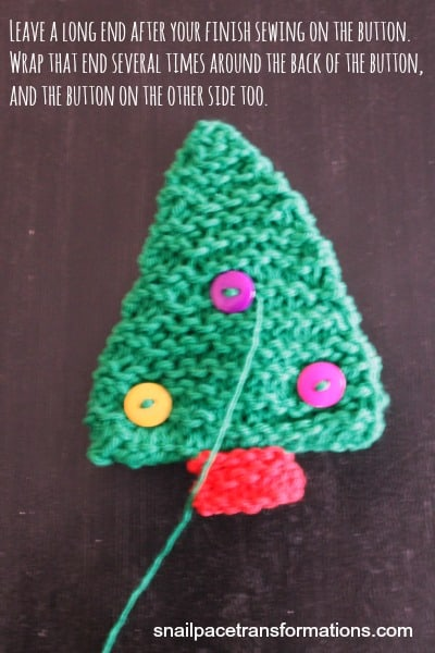 Christmas tree ornament wrapping thread around button