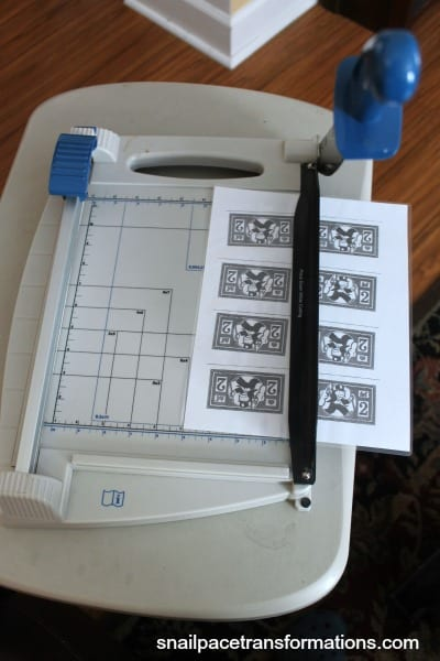 large paper cutter slicing chore money in half