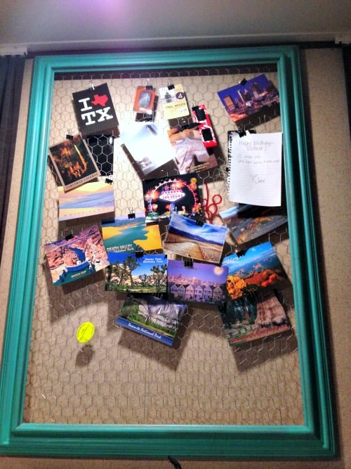 Simple yard sale frame lined with chicken wire and hung in an RV to hold postcards from places we have traveled.