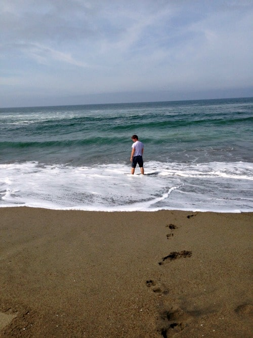 Road trip: Playing in the waves of the Pacific Ocean.