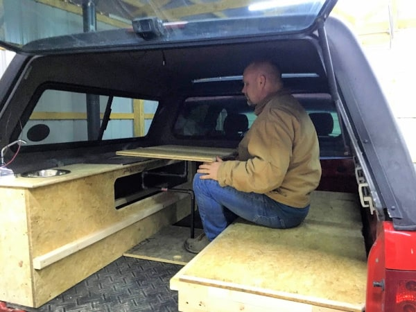 What our DIY truck topper camper table looks like.